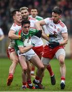 3 February 2019; Ciaran Treacy of Mayo in action against Kieran McGeary, left, and Matthew Donnelly of Tyrone during the Allianz Football League Division 1 Round 2 match between Tyrone and Mayo at Healy Park in Omagh, Tyrone. Photo by Oliver McVeigh/Sportsfile