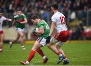 3 February 2019; Andy Moran of Mayo takes a forward mark ahead of Matthew Donnelly of Tyrone during the Allianz Football League Division 1 Round 2 match between Tyrone and Mayo at Healy Park in Omagh, Tyrone. Photo by Oliver McVeigh/Sportsfile