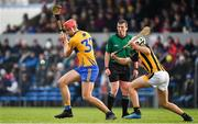 3 February 2019; Peter Duggan of Clare in action against Padraig Walsh of Kilkenny watched by referee Paud O'Dwyer during the Allianz Hurling League Division 1A Round 2 match between Clare and Kilkenny at Cusack Park in Ennis, Co. Clare. Photo by Brendan Moran/Sportsfile