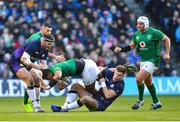 9 February 2019; Bundee Aki of Ireland is tackled by Simon Berghan, left, and Huw Jones of Scotland during the Guinness Six Nations Rugby Championship match between Scotland and Ireland at the BT Murrayfield Stadium in Edinburgh, Scotland. Photo by Ramsey Cardy/Sportsfile