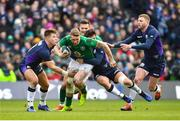 9 February 2019; Chris Farrell of Ireland is tackled by Sam Johnson, left, and Huw Jones of Scotland during the Guinness Six Nations Rugby Championship match between Scotland and Ireland at the BT Murrayfield Stadium in Edinburgh, Scotland. Photo by Ramsey Cardy/Sportsfile