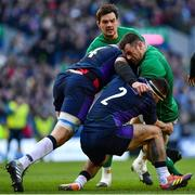 9 February 2019; Cian Healy of Ireland is tackled by Grant Gilchrist, left, and Stuart McInally of Scotland during the Guinness Six Nations Rugby Championship match between Scotland and Ireland at the BT Murrayfield Stadium in Edinburgh, Scotland. Photo by Ramsey Cardy/Sportsfile