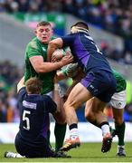 9 February 2019; Tadhg Furlong of Ireland is tackled by Jonny Gray, left, and Stuart McInally of Scotland during the Guinness Six Nations Rugby Championship match between Scotland and Ireland at the BT Murrayfield Stadium in Edinburgh, Scotland. Photo by Ramsey Cardy/Sportsfile