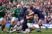9 February 2019; Conor Murray of Ireland is tackled by Grant Gilchrist, left, and Jamie Ritchie of Scotland during the Guinness Six Nations Rugby Championship match between Scotland and Ireland at the BT Murrayfield Stadium in Edinburgh, Scotland. Photo by Brendan Moran/Sportsfile