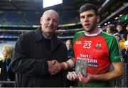 9 February 2019; Denis O'Callaghan, Head of Retail Banking, presents Kevin McCarthy of Kilcummin with the Man of the Match award for his outstanding performance in the AIB GAA All-Ireland Intermediate Football Club Championship Final match between Kilcummin and Naomh Éanna at Croke Park in Dublin on Saturday, February 9th. For exclusive content and behind the scenes action follow AIB GAA on Facebook, Twitter, Instagram, Snapchat and on www.aib.ie/gaa. Photo by Piaras Ó Mídheach/Sportsfile