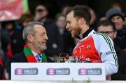 9 February 2019; Former GAA President Seán Kelly in conversation with his clubmate Kilcummin captain Brendan Kealy before presenting him with the cup after the AIB GAA Football All-Ireland Intermediate Championship Final match between Kilcummin and Naomh Éanna at Croke Park in Dublin. Photo by Piaras Ó Mídheach/Sportsfile