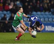 9 February 2019; Thomas Galligan of Cavan in action against Andy Moran of Mayo during the Allianz Football League Division 1 Round 3 match between Mayo and Cavan at Elverys MacHale Park in Castlebar, Mayo. Photo by Seb Daly/Sportsfile