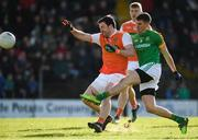 10 February 2019; Shane McEntee of Meath scores a point despite the attention of Aidan Forker of Armagh during the Allianz Football League Division 2 Round 3 match between Meath and Armagh at Páirc Tailteann in Navan, Meath. Photo by Eóin Noonan/Sportsfile