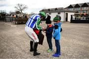 10 February 2019; Jockey Davy Russell signs an autograph for brothers Joe, age 6, and Sam Widger, age 8, from Co Waterford following the I.N.H. Stallion Owners EBF Novice Hurdle at Punchestown Racecourse in Naas, Co. Kildare. Photo by David Fitzgerald/Sportsfile