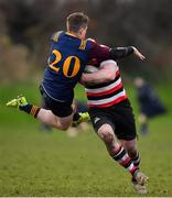 10 February 2019; Lorcan Jones of Skerries attempts to stop the progress of Daniel Pim of Enniscorthy during the Bank of Ireland Provincial Towns Cup Round 2 match between Skerries RFC and Enniscorthy RFC at Skerries RFC in Skerries, Dublin. Photo by Brendan Moran/Sportsfile
