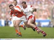 28 September 2003; Gerard Cavlan, Tyrone, in action against Armagh's Aidan O'Rourke. Bank of Ireland All-Ireland Senior Football Championship Final, Armagh v Tyrone, Croke Park, Dublin. Picture credit; Matt Browne / SPORTSFILE *EDI*