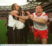 28 September 2003; Tyrone manager Mickey Harte is congratulated by Paddy Tally as Tyrone's Peter Loughran, right, celebrates. Bank of Ireland All-Ireland Senior Football Championship Final, Armagh v Tyrone, Croke Park, Dublin. Picture credit; Ray McManus / SPORTSFILE