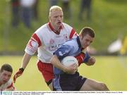 4 October 2003; Niall Cooper, Dublin, in action against Tyrone's Aiden McCarron. All-Ireland U21 Football Championship Final, Dublin v Tyrone, Pairc Tailteann, Navan, Co. Meath. Picture credit; Matt Browne / SPORTSFILE *EDI*