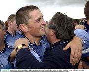 4 October 2003; Dublin captain Alan Brogan is congratulated by manager Tommy Lyons at the final whistle after victory over Tyrone. All-Ireland U21 Football Championship Final, Dublin v Tyrone, Pairc Tailteann, Navan, Co. Meath. Picture credit; Matt Browne / SPORTSFILE *EDI*