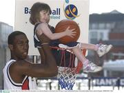 9 October 2003; Notre Dame's Bruce Jolly slam dunks 3 year old Laura Roantree at the launch of the ESB Super League and Basketball Ireland. Clarion Hotel, Dublin. Picture credit; Pat Murphy / SPORTSFILE *EDI*