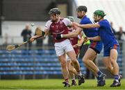14 February 2019; Conor Caulfield of NUI Galway is tackled by Colin Guilfoyle, centre, and Gary Cooney of Mary Immaculate College during the Electric Ireland Fitzgibbon Cup Semi-Final match between National University of Ireland Galway and Mary Immaculate College Limerick at Cusack Park in Ennis, Clare. Photo by Eóin Noonan/Sportsfile