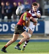 14 February 2019; Hugo Philips of Clongowes Wood is tackled by James Reynolds of CBC Monkstown during the Bank of Ireland Leinster Schools Senior Cup Round 2 match between Clongowes Wood College and CBC Monkstown at Energia Park in Donnybrook, Dublin. Photo by Matt Browne/Sportsfile