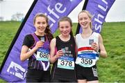 15 February 2019; Niamh O'Mahony, centre, from Presentation Tralee, Co Kerry, after winning the Intermediate Girls 3000m with second place Una O'Brien, left, from Dunmore and third place Emma Landers, right, from Youghal during the Irish Life Health Munster Schools Cross Country event at WIT Sports Campus in Carrignore, Waterford. Photo by Matt Browne/Sportsfile