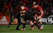 15 February 2019; Rory Scannell of Munster is tackled by Berton Klaasen, left, and Schalk Ferreira of Southern Kings during the Guinness PRO14 Round 15 match between Munster and Southern Kings at Irish Independent Park in Cork. Photo by Diarmuid Greene/Sportsfile