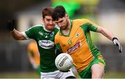16 February 2019; Martin Farragher of Corofin in action against Criostóir Mac Pháidín of Gaoth Dobhair during the AIB GAA Football All-Ireland Senior Championship Semi-Final match between Corofin, Galway, and Gaoth Dobhair, Donegal, at Avantcard Páirc Sean Mac Diarmada in Carrick-on-Shannon, Leitrim. Photo by Stephen McCarthy/Sportsfile