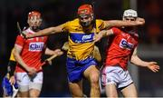 16 February 2019; Peter Duggan of Clare in action against David Griffin of Cork, as Bill Cooper, left, looks on during the Allianz Hurling League Division 1A Round 3 match between Cork and Clare at Páirc Uí Rinn in Cork. Photo by Piaras Ó Mídheach/Sportsfile