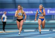 17 February 2019; Athletes from left, Joan Healy of Leevale AC, Co. Cork, and Molly Scott of St. L. O'Toole AC, Co. Carlow, competing in the women's 60m event  during day two of the Irish Life Health National Senior Indoor Athletics Championships at the National Indoor Arena in Abbotstown, Dublin. Photo by Eóin Noonan/Sportsfile