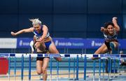 17 February 2019; Molly Scott of St. L. O'Toole AC, Co. Carlow, left, and Kate Doherty of Dundrum South Dublin AC, Co. Dublin, competing in the 60m Hurdles event during day two of the Irish Life Health National Senior Indoor Athletics Championships at the National Indoor Arena in Abbotstown, Dublin. Photo by Sam Barnes/Sportsfile