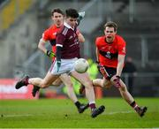 17 February 2019; Jack Robinson of NUIG kicks a point under pressure from Cian Kiely of UCC during the Electric Ireland Sigerson Cup semi-final match between University College Cork and National University of Ireland, Galway at Mallow GAA in Mallow, Cork. Photo by Seb Daly/Sportsfile