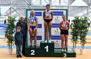 17 February 2019; Liam Hennessy, Past President, Athletics Ireland, with women's 60m hurrdles medalists, from left, Molly Scott of St. L. O'Toole AC, Co, Carlow, Silver, Kate Doherty of Dundrum South Dublin AC, Co Dublin, Gold and Sarah Quinn of St. Colmans South Mayo AC, Co. Mayo, Bronze during day two of the Irish Life Health National Senior Indoor Athletics Championships at the National Indoor Arena in Abbotstown, Dublin. Photo by Eóin Noonan/Sportsfile