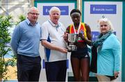 17 February 2019; Rhasidat Adeleke of Tallaght AC, Co. Dublin, is presented with the trophy by from left, Hamish Adams, Athletics Ireland CEO, John McGrath, and Athletics Ireland President Georgina Drumm during day two of the Irish Life Health National Senior Indoor Athletics Championships at the National Indoor Arena in Abbotstown, Dublin. Photo by Sam Barnes/Sportsfile