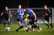 22 February 2019; Kevin Coffey of UCD in action against Paddy Kirk of Bohemians during the SSE Airtricity League Premier Division match between UCD and Bohemians at the UCD Bowl in Dublin. Photo by Harry Murphy/Sportsfile