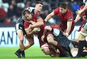 22 February 2019; Arno Botha of Munster is tackled by Matthew Aubrey and Sam Cross of Ospreys during the Guinness PRO14 Round 16 match between Ospreys and Munster at Liberty Stadium in Swansea, Wales. Photo by Ben Evans/Sportsfile