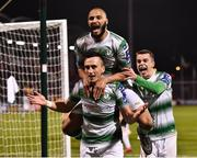 22 February 2019; Aaron McEneff of Shamrock Rovers, centre, celebrates with team-mates Ethan Boyle, top, and Sean Kavanagh, after scoring his side's second goal during the SSE Airtricity League Premier Division match between Shamrock Rovers and Derry City at Tallaght Stadium in Dublin. Photo by Seb Daly/Sportsfile