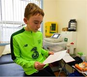 23 February 2019; Alex McKenna, age 12, from Duleek, Co. Meath, with his ECG during the Mrs. Brown's Boys FAI Heart Care Programme at United Park in Drogheda, Co Louth. Photo by Seb Daly/Sportsfile