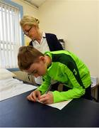 23 February 2019; Alex McKenna, age 12, from Duleek, Co. Meath, initials his ECG in front of Cardiac Technician Christine Kiernan during the Mrs. Brown's Boys FAI Heart Care Programme at United Park in Drogheda, Co Louth. Photo by Seb Daly/Sportsfile