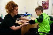 23 February 2019; Alex McKenna, age 12, from Duleek, Co. Meath, has his heart pressure taken by Dr. Ciara McKeogh during the Mrs. Brown's Boys FAI Heart Care Programme at United Park in Drogheda, Co Louth. Photo by Seb Daly/Sportsfile