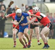 23 February 2019; Aaron Gillane of Mary Immaculate College in action against Chris O'Leary, left, and Niall O'Leary of University College Cork during the Electric Ireland HE GAA Fitzgibbon Cup Final match between Mary Immaculate College and University College Cork at Waterford IT in Waterford. Photo by Matt Browne/Sportsfile