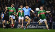 23 February 2019; Con O'Callaghan of Dublin, under pressure from Mayo players Kevin McLoughlin, left, and Colm Boyle, kicks his side's 8th point in the 48th minute during the Allianz Football League Division 1 Round 4 match between Dublin and Mayo at Croke Park in Dublin. Photo by Ray McManus/Sportsfile