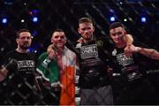 23 February 2019; Kiefer Crosbie celebrates with his corner following his Welterweight bout with Daniel Olejniczak during Bellator 217 at the 3 Arena in Dublin. Photo by David Fitzgerald/Sportsfile