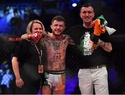 23 February 2019; James Gallagher celebrates with his mother Doreen and father Andy following his Bantamweight bout with Steven Graham during Bellator 217 at the 3 Arena in Dublin. Photo by David Fitzgerald/Sportsfile
