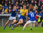 24 February 2019; Enda Smith of Roscommon in action against Conor Moynagh, left, and Dara McVeety of Cavan during the Allianz Football League Division 1 Round 4 match between Cavan and Roscommon at the Kingspan Breffni Park in Cavan. Photo by Seb Daly/Sportsfile
