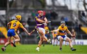 24 February 2019; Lee Chin of Wexford is hooked by Colm Galvin of Clare during the Allianz Hurling League Division 1A Round 4 match between Clare and Wexford at Cusack Park in Ennis, Clare. Photo by Eóin Noonan/Sportsfile