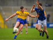 24 February 2019; Conor Cox of Roscommon kicks a point under pressure from Ciaran Brady of Cavan during the Allianz Football League Division 1 Round 4 match between Cavan and Roscommon at the Kingspan Breffni Park in Cavan. Photo by Seb Daly/Sportsfile