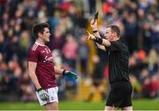 24 February 2019; Barry McHugh of Galway receives a black card from referee Joe McQuillan during the Allianz Football League Division 1 Round 4 match between Galway and Kerry at Tuam Stadium in Tuam, Galway.  Photo by Stephen McCarthy/Sportsfile