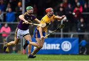 24 February 2019; Peter Duggan of Clare is fouled by Matthew O'Hanlon of Wexford resulting in a penalty during the Allianz Hurling League Division 1A Round 4 match between Clare and Wexford at Cusack Park in Ennis, Clare. Photo by Eóin Noonan/Sportsfile