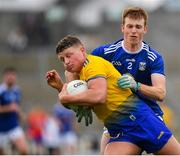 24 February 2019; Conor Cox of Roscommon in action against Jason McLoughlin of Cavan during the Allianz Football League Division 1 Round 4 match between Cavan and Roscommon at the Kingspan Breffni Park in Cavan. Photo by Seb Daly/Sportsfile