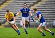24 February 2019; Conor Cox of Roscommon in action against Martin Reilly, centre, and Jason McLoughlin of Cavan during the Allianz Football League Division 1 Round 4 match between Cavan and Roscommon at the Kingspan Breffni Park in Cavan. Photo by Seb Daly/Sportsfile