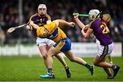 24 February 2019; Jason McCarthy of Clare is tackled by Liam Ryan of Wexford during the Allianz Hurling League Division 1A Round 4 match between Clare and Wexford at Cusack Park in Ennis, Clare. Photo by Eóin Noonan/Sportsfile