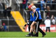 24 February 2019; John Conlon of Clare is helped off the pitch after going over on his ankle during the Allianz Hurling League Division 1A Round 4 match between Clare and Wexford at Cusack Park in Ennis, Clare. Photo by Eóin Noonan/Sportsfile