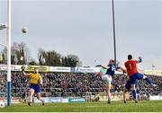 24 February 2019; Martin Reilly of Cavan out-jumps Darren O'Malley and Conor Hussey of Roscommon to score his side's third goal of the game during the Allianz Football League Division 1 Round 4 match between Cavan and Roscommon at the Kingspan Breffni Park in Cavan. Photo by Seb Daly/Sportsfile